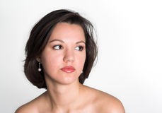 Portrait of an attractive young woman looking to right. Naked shoulders portrait of an attractive young woman looking to right; head and shoulders; dark hair Stock Photography