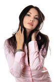 Portrait of attractive young woman in pink shirt Stock Photos