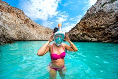 Portrait of attractive young woman posing with snorkeling mask, smiling Stock Photo