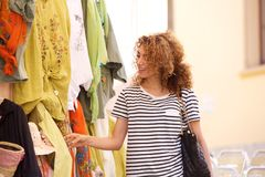 Attractive young woman shopping for clothes Stock Photo