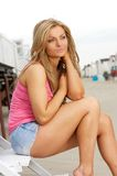 Portrait of an attractive young woman sitting outdoors Royalty Free Stock Photo