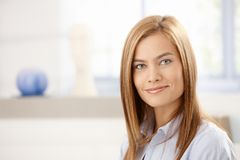 Portrait of attractive young woman smiling Stock Photos