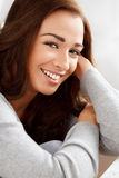 Portrait of an attractive young woman smiling. Attractive young woman smiling at home Stock Photo