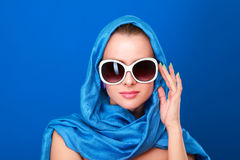 Portrait of an attractive young woman in sunglasses. Retro style Royalty Free Stock Image