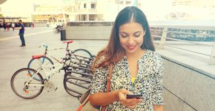 Portrait of an attractive young woman using a smartphone. Executive working with a mobile phone in the street. Panoramic banner v royalty free stock photography