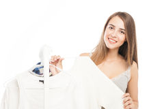 Portrait of attractive young woman with white shirts in hands Royalty Free Stock Images