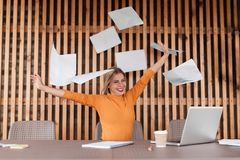 Portrait of attractive young woman on workplace, celebration and success