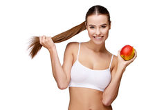 Portrait of attractivesmiling woman holding apple isolated on white. Portrait of attractive caucasian smiling woman holding apple isolated on white Royalty Free Stock Photo