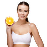 Portrait of attractivesmiling woman holding orange isolated on white Stock Photos