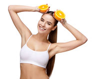 Portrait of attractivesmiling woman holding orange isolated on white Royalty Free Stock Photos