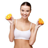 Portrait of attractivesmiling woman holding orange isolated on white Stock Images