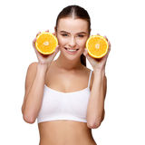 Portrait of attractivesmiling woman holding orange isolated on white Royalty Free Stock Images