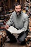 Portrait of authentic senior man on book market Stock Images