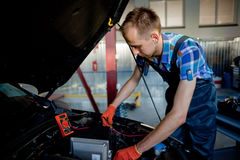 Portrait of an auto mechanic at work Stock Photo