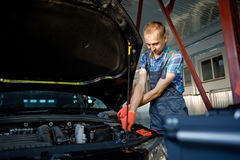 Portrait of an auto mechanic at work Royalty Free Stock Photo