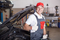 Portrait of an auto mechanic at work Stock Image