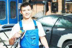 Portrait of auto mechanic worker with power polisher machine Royalty Free Stock Images