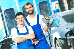 Portrait of auto mechanic workers with power polisher machine Stock Image