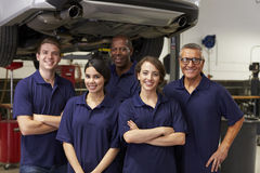 Portrait Of Auto Mechanics Working In Garage stock photo