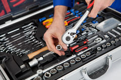 Portrait of automechanic taking a wrench Stock Photography