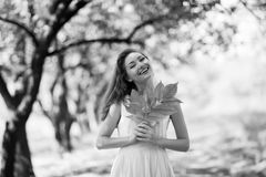 Portrait of autumn happy woman. With leaves Stock Photo