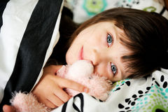 Portrait of awaken little girl in bed Royalty Free Stock Photo