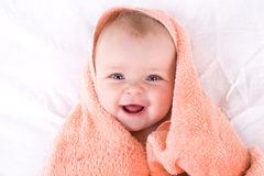 Portrait of a baby. A cute baby wrapped in a towel Royalty Free Stock Photo