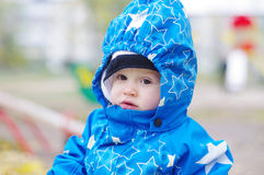 Portrait of baby age of 1 year outdoors Stock Image
