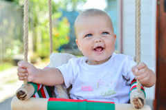 Portrait of baby with in backyard swing Royalty Free Stock Photography