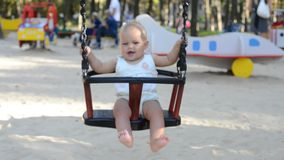 Portrait of baby with in backyard swing stock video