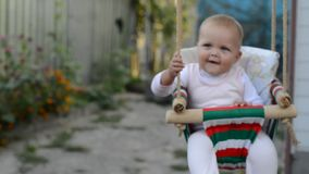 Portrait of baby with in backyard swing stock video footage