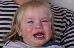Portrait baby blonde hair emotion crying tears Stock Photos