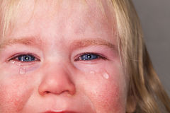 Portrait baby blonde hair emotion crying tears Royalty Free Stock Photos