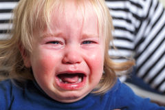 Portrait baby blonde hair emotion crying tears Stock Photography