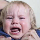 Portrait baby blonde hair emotion crying tears Royalty Free Stock Image
