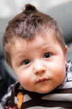 Portrait of baby boy. Portrait of cute baby boy with tufted hair Stock Images