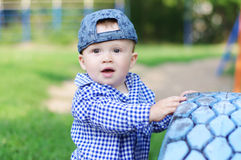 Portrait of baby boy age of 10 months outdoors Royalty Free Stock Image