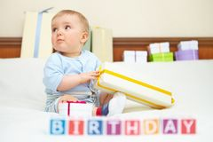 Portrait of baby boy on bed. Birthday concept. Stock Image