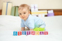 Portrait of baby boy on bed. Birthday concept. Stock Images