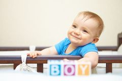 Portrait of baby boy in bed. Gender concept. Royalty Free Stock Photography