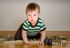 Portrait Of Baby Boy Crawling Stock Image