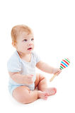 Portrait of baby boy with rattle Stock Images