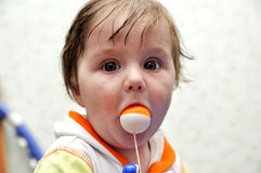Portrait baby boy with toy ball in mouth Stock Photos