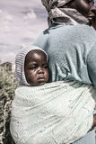 Portrait on a baby carried by her mother, Botswana Royalty Free Stock Image