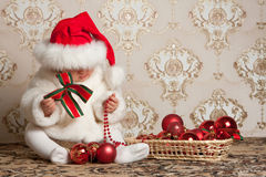 Portrait of a baby in a Christmas hat Royalty Free Stock Images