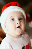 Portrait of a baby in Christmas hat Royalty Free Stock Image
