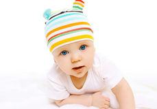 Portrait of baby in colorful hat on a white Royalty Free Stock Image