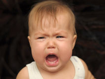 Portrait of baby crying Stock Images