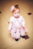 Baby dressed in pink dress Stock Photo