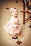 Baby dressed in pink dress Royalty Free Stock Images